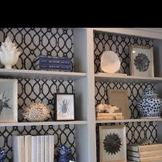 Open shelves with patterned background.