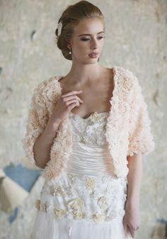 """Perfect match for the wedding dress when the evening cools off: Forever Fancy Rosette Bolero 76.99 at shopruche.com. A garden of raw edged chiffon rosettes blooms on this peach bolero. Polished with three-quarter length sleeves and an open silhouette. Semi-sheer. Fully lined.  Shell: 100% Polyester, Lining: 100% Polyester, Imported, 19"""" length from top of shoulders"""