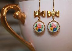 Vintage Painted Glass Cabochons (from the 1950's) set with brass bows on gold plated ear wire by Baby Raindrops on Etsy, $18.00.