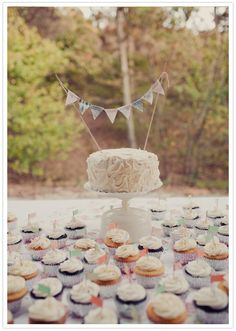 simple white wedding cake and cupcakes