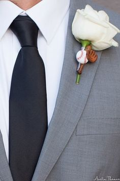 Fun Groom's boutonniere using baseball embellishments for a true baseball fan by House of Flowers Bakersfield, Ca.