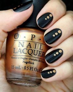 Elegant Black And Gold Dotted Nail Art