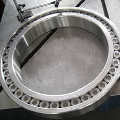 mounted intermediate the inner and outer rims rims, able to withstand greater loads. Also known as ball bearings.