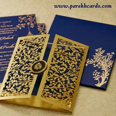 The invitation card is made out of high quality Blue paper board with matching mailing box envelope and coordinated inserts inside. Card front has a beautiful golden tree laser cut design with rich style of Door opening. Card front also has round wooden lasercut pasteup in center with Gold plated Ganesh paste-up on top.