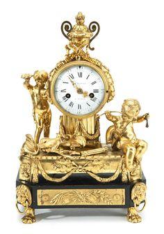 A LOUIS XVI ORMOLU AND EBONIZED MANTEL CLOCK CIRCA 1770, THE DIAL SIGNED LE NEPVEU A PARIS