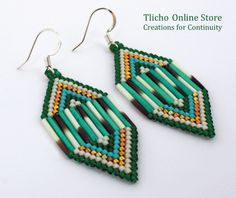 Turquoise and Gold Diamond Shaped Earrings. $78. Available at http://tlicho.ca/   Delica beads, 14 karat Gold Delica Beads, Dyed and Natural Porcupine Quills, Surgical Steel Hooks.