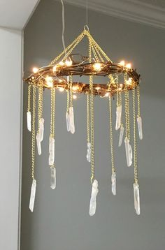 Romantic rustic crystal chandelier using natural Quartz points, reclaimed wood and gold chain. This is great for inside the barbacue arbor!!!- best bohemian Etsy shops