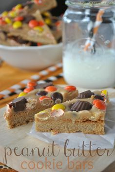 Peanut Butter Cookie Bars- triple layer #peanutbutter bars with Reese's cups and pieces! #dessert www.shugarysweets.com