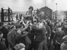 Jubilant Russian POWs lifting up an American soldier after the US 9th Army liberated them from Stalag 329 near Eselheide, Germany. Photo credit: Fred Ramage