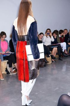 Bazaar is showcasing the IPAD case designed by Celine but I couldn't keep my eyes off the coat.