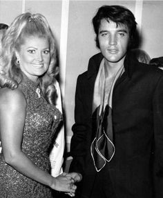 Elvis press conference , august 1 1969 in Las Vegas . Elvis at the reception after the press conference . Here with the Sheraton director's wife.