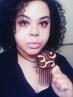 Bassist and Supporter Rose Neurosis!!!    Afrofuturistic Styling Combs and Afro picks hand made from exotic hardwoods for Natural Hair, Curly Hair and Kinky Hair! www.carbon-ar.com Namaste!
