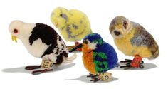 FOUR STEIFF POM-POM BIRDS: Owl, (1508), grey, brown, yellow and white wool, brown and black glass eyes, metal feet and FF button with red cloth tag, 1934-39 --2.5cm. (6.5cm.) high; Seagull, (1509), brown and white wool, black glass eyes, red discs behind and FF button with cream card tag, 1936-40 --2.5in. (6.5cm.) high (feet rubbed); Kingfisher, (6508,10), blue, green, brown and white, FF button with cream paper tag, 1939-43 --2in. (5cm.) high; and Woollen Bird, (6508,6), yellow and grey, FF…