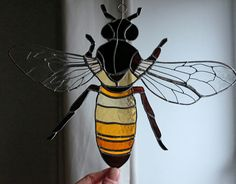 Stained glass Honey Bee suncatcher. Designed and made as a commission by Glastonbury Stained Glass (Richard Pelham). 30cm wingspan.