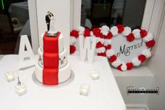 Movie themed wedding cake, red carpet, hollywood star wedding cake. White and red wedding cake.