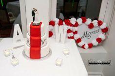 Movie themed wedding cake, red carpet, hollywood star wedding cake. White and red wedding cake.