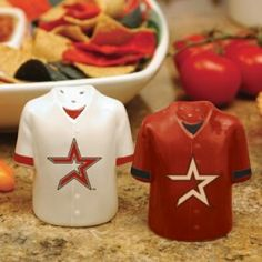 """Houston Astros MLB Gameday Jersey Salt And Pepper Shakers by Caseys. $28.95. These ceramic shakers are hand painted and durable enough to handle everyday use! The salt and pepper shakers feature your favorite teams logo. 3.5"""" tall by 3"""" wide."""