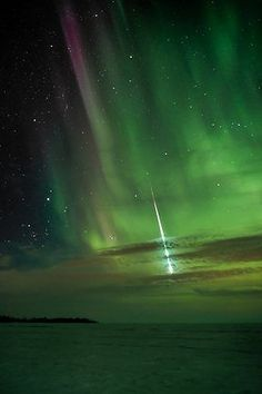 An aurora and a fireball near Manitoba, Canada ~ Photo: Shannon Bikelski