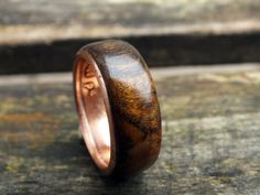 This is cool. Made out of an Irish ring. -- Wood wedding ring Luck Irish penny coin ring by KINGOFTHERINGS, $120.00