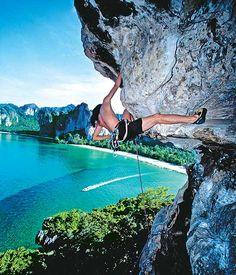 Rock-climbing off a limestone cliff @ Railay Beach, Krabi province, Thailand