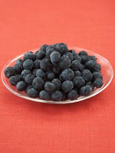 85 Calories - 1 cup blueberries. Read more: Weight Loss Tips - 100 Calorie Snacks at WomansDay.com - Woman's Day