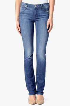 d149286d8e0 Our Carly Straight Leg in light blue Rising Sun wash is designed with a  true straight leg from knee to leg opening. It features our iconic  signature back ...