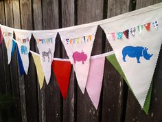Party Animal Bunting Flags hand painted fabric pennant flags with Safari Animals and mini buntings sewed on each flag. $39.00, via Etsy.
