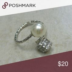 WHITE PEARL & CRYSTAL CUBE SILVER SPIRAL RING NIP SILVER PAVE CRYSTAL CUBE PEARL SPIRAL RING NWT brand new in original packaging! Silver spiral ring w/ embellished crystal cube & a pearl at the meeting ends of ring!  trendy stylish fashionable, variety of sizes! 6 available! High quality silver plated alloy & imitation white pearl. *Nickel & Lead Compliant!* -Also available in gold, see separate listing-  Bundle & save! Grab them while they last!! Jewelry Rings