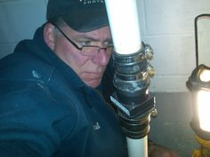 Paul, contorted around a sump pump, trying to do a boiler repair!