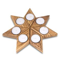 The set is made up of seven diamond-shaped tealight holders that can be arranged…