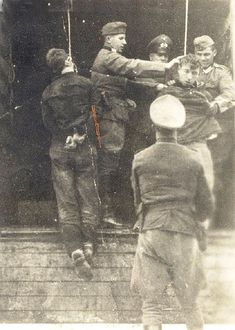 German soldiers hanging two Jews in the Vilna ghetto.