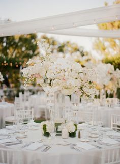 Gorgeous ivory and blush centerpieces: http://www.stylemepretty.com/2015/01/08/elegant-blush-ivory-outdoor-wedding/ | Photography: Sylvie Gil - http://www.sylviegilphotography.com/