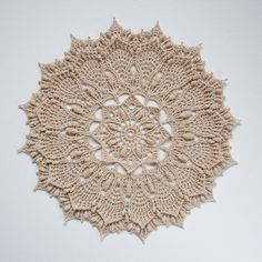 Textured crochet doily with intricate details.   This pattern is written-only instructions, includes pictures to some rounds to guide you through tricky stitches. Pattern uses U.S./American terminology, is worked in rounds and consists of 31 rounds.  Pattern will be available for download in PDF fo