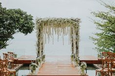 Ceremonial arch dripping with white flowers   | Image by diktat photography