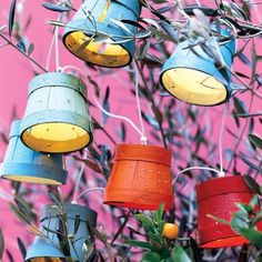 Wooden pots garland lights. I am sure this would work with plastic potting planters the throw away ones. You could paint them and put designs on them for added interest. It would be a great upcycle for the garden