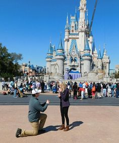 He asked her to marry him right in front of Cinderella's castle, and it's beyond romantic. <3