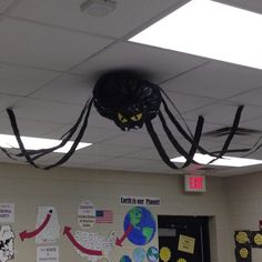 "A big spider that I made to hang in my classroom for the month of October. The kids used balloons, yarn, and glue to make ""spider eggs"" that hung around the room in the ""web"". Big spider is made of a black trash bag stuffed with plastic grocery bags, tied off, shaped and hung with fishing line. Legs are black streamers."