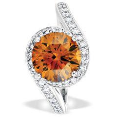 De Beers 1888 Masters Diamonds Caress ring with a fancy orange round brilliant-cut diamond and diamond pavé set in platinum.