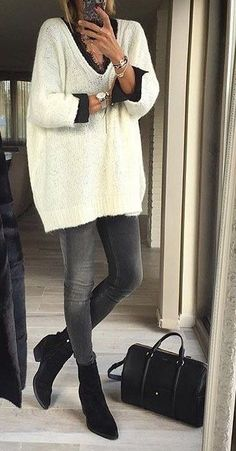 Cute oversized winter white sweater with gray jeans and black top.