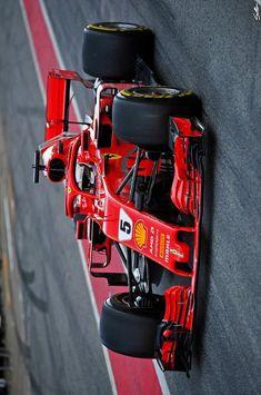 6232369a641 Sebastian Vettel driving through the pit lane during testing