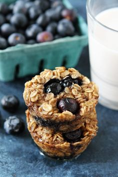 Banana Blueberry Baked Oatmeal Cups Recipe on twopeasandtheirpod.com Kids and adults love these easy baked oatmeal muffins! They are great for breakfast on the go or snack time!