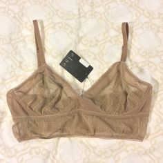 NWT Else Zig-Zag Long Line Sheer Tan Bra, 32D Purchased from the top lingerie store in Williamsburg, BK! Brand new, sheer zig zag long line triangle bra in a mauve/dark tan from lingerie designer Else in size 32D. ‼️Don't forget = 15% off your purchase or more when you bundle 2 or more items from my closet and get 15% off‼️ offers welcome please use button above - thanks! Else Other