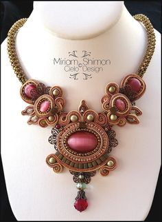 This necklace uses raspberry colored glass cabochons wrapped in faint rose, copper and vanilla soutache, embellished with frosted olive cubes, matte
