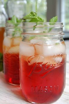 Spiked Pomegranate Iced Tea takes your favorite summer iced tea and adds Pomegranate Liqueur  vodka and fresh mint to create a refreshing summer cocktail that you can sip at your next backyard festivities.//A Cedar Spoon