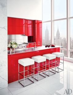 Red-lacquer cabinetry in the petite kitchen of a New York duplex designed by ODA-Architecture