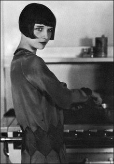 Louise Brooks showing her domestic side, 1927