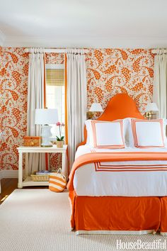 Spicy orange energizes the master bedroom in a Bahamas house decorated by Amanda Lindroth. China Seas' Lysette linen covers the walls, and the headboard is upholstered in a Norbar canvas. Meridian bed linens, Matouk. Hamilton table, Bunny Williams.   - HouseBeautiful.com