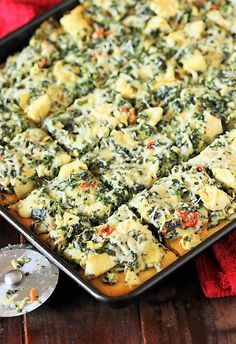 Spinach and Artichoke Dip Party Squares ~ Bake it on a crescent roll crust and turn everyone's favorite Spinach & Artichoke Dip into delicious party squares! Perfect for gobbling up during game day watching.