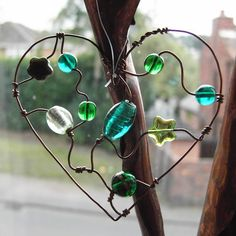 Green Heart - a beaded suncatcher glass beads: http://www.ecrafty.com/c-2-glass-beads.aspx
