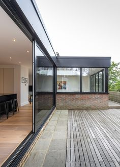 Large external sliding door | floor to ceiling doors | flat roof rear extension | contemporary design | timber decking | corner windows |